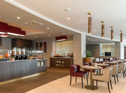 Overview of Breakfast Service Area, Tables and Chairs in Dining Area in Restaurant