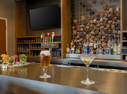 Detailed View of Cocktails on Counter by Fully Stocked Quarry Bar