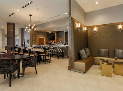 Soft Seating and Tables in Lounge Area With Counter Seating and TV at Fully Stocked Quarry Bar