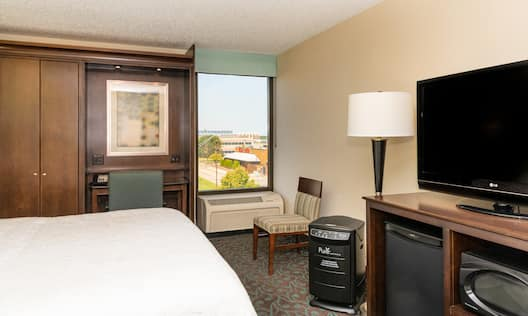 Guest Room with King Bed, Work Desk, and TV