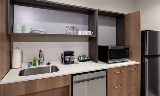 Kitchen area with sink and fridge