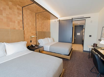 Two Beds and Desk in Hotel Guest Room