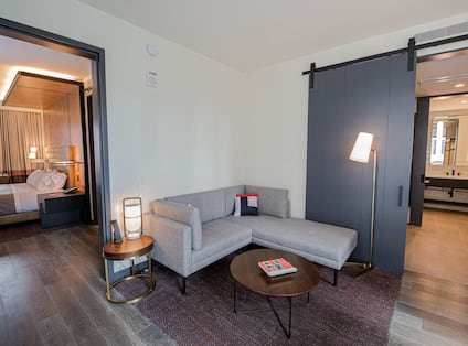 Suite Living Area and View of Separate Bedroom and Bathroom