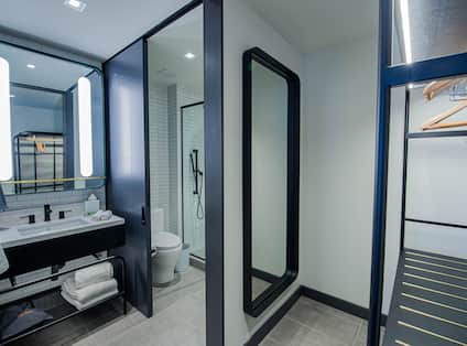 Bathroom Vanity and View of Large Mirror in Closet