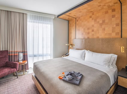 Suite with Robe and Sleepers on Bed