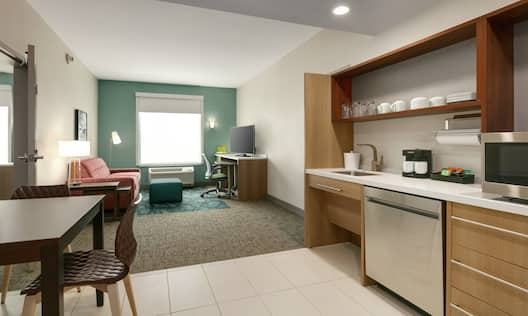 Spacious Accessible Suite featuring fully equipped kitchen lounge area and private bedroom
