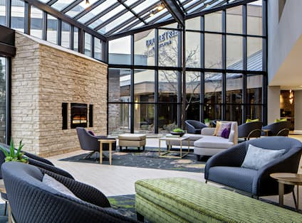 Cozy Lobby Seating Area with Fireplace