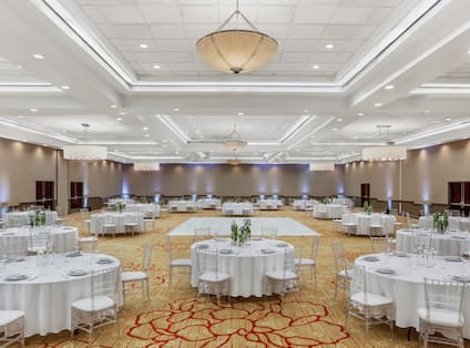 round banquet tables in a ballroom with a dance floor