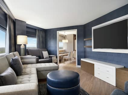 Suite Living Area with Large Sofa and HDTV