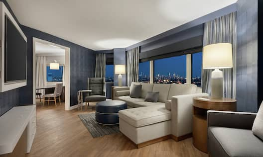 Suite Living Room with Large Windows and City Views