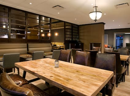 View of Table and Booth Seating in Hudson Grille Dining Area