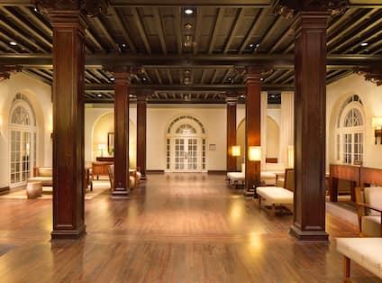Casa Marina large, open lobby with wood floors and pillars