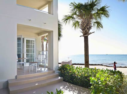 View of Ocean View Suite patio next to the beach