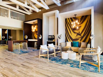 Ceiling Fans, Decorative Lighting, Beverage Stations,Tables, Chairs, and Sofa in Lobby Lounge Area
