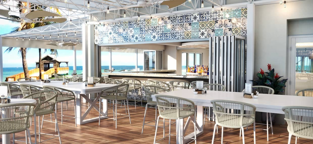 Four Marlins Hotel Bar and Restaurant Seating Area with Ocean views
