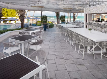 Four Marlins Restaurant Terrace Setup for Dining with Beach View