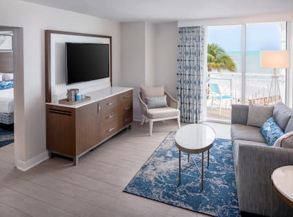 Overview of Suite Lounge Area with Balcony and Partial View of Separate Bedroom