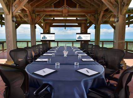 Large table setup for meeting at Overseas Gazebo by the beach