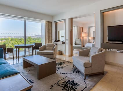 Living Area of King Deluxe Suite with Pool View
