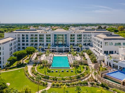 Aerial View of Hotel Exterior and Outdoor Pool Area