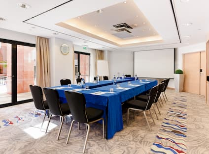Meeting Room With U-Shaped Table and Projector