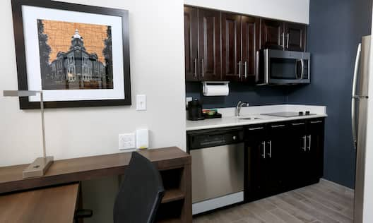 Guest Suite Work Desk and Kitchen Area with Microwave and Dishwasher