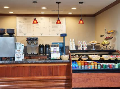 Menu Display and Items for Purchase at Service Counter of Java Stop Coffee Shop