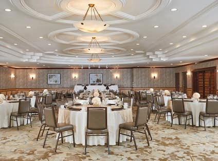 Round Dining Tables With Place Settings on White Linens in Sequoia Event Space