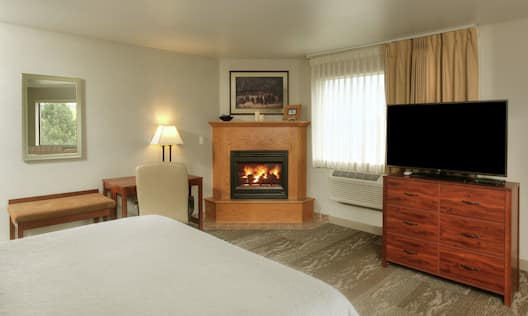 King suite with jetted tub, fireplace and TV