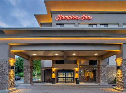 Illuminated Front Entrance of Hampton Inn Hotel at Night