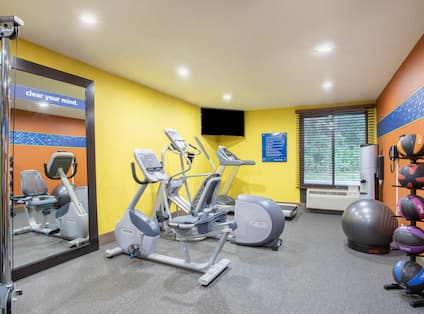 Fitness Center with Recumbent Bike and Exercise Balls