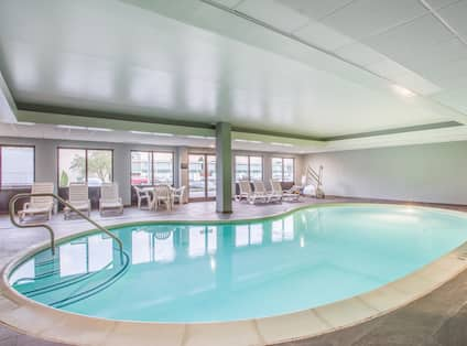 Indoor Pool with Seating Area and Large Windows