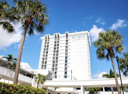 Exterior View of Hotel Tower with Palm Trees