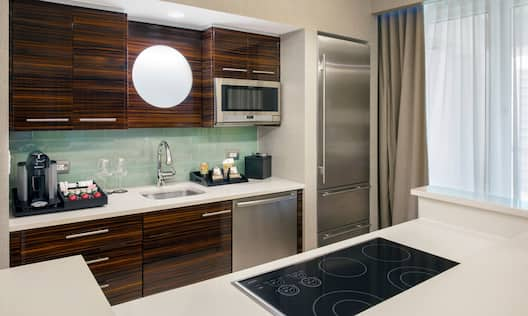 Guest Kitchen Counter Area with Sink, Microwave, and Fridge