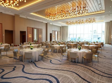 Spacious Ballroom Area with Round Tables and Chairs