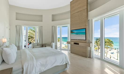 Presidential Suite Bedroom with Seating Area and View of the Beach