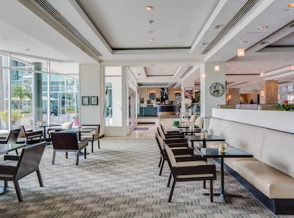Lower Level Lounge With Tables, Chairs, Booths, and Windows With View of Intercoastal Waterway