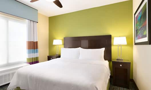 Suite Bedroom with King Bed and Nightstands