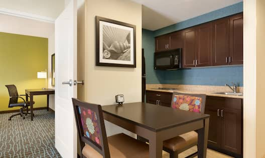 Suite Living Area with Kitchen and Work Desk