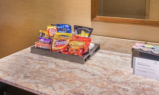 Close Up of Snacks and Coffee Pods on Table in Premium Suite