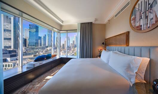 Presidential Suite Bed with Window View