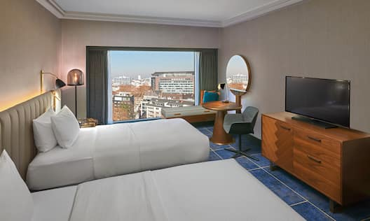 Twin Guest Room with Desk HDTV and City View