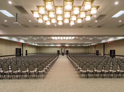 Event Room in Theater Layout With Chairs Facing Podium