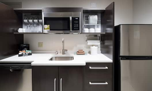 Kitchen area with sink and microwave