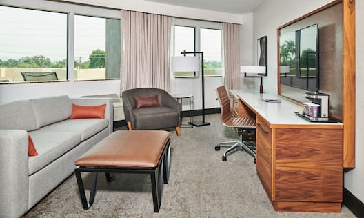 Living Room and Desk in Guest Room with Balcony
