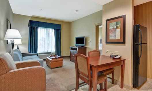 Suite Showing Lounge Area and Refrigerator