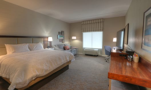 One King Bed Guest Bedroom with Sofa, Work Desk and HDTV