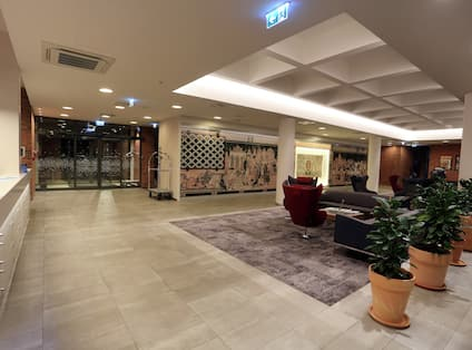 View of Entrance and Seating Area in Hotel Lobby