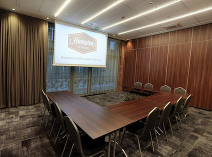 Conference Room with Three Tables and Projector Screen