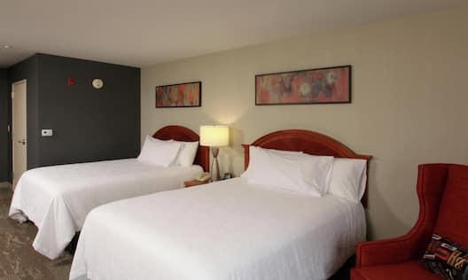 Two Queen Beds Guest Bedroom with Armchair